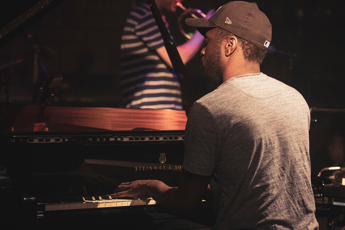 Alfa Mist playing a grand piano