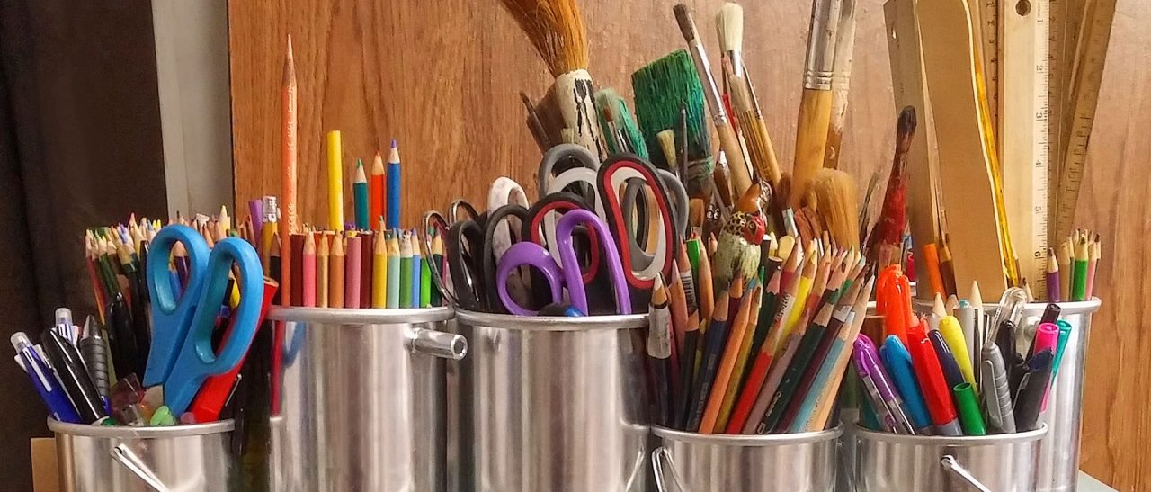Pots of pencils and pens for crafts