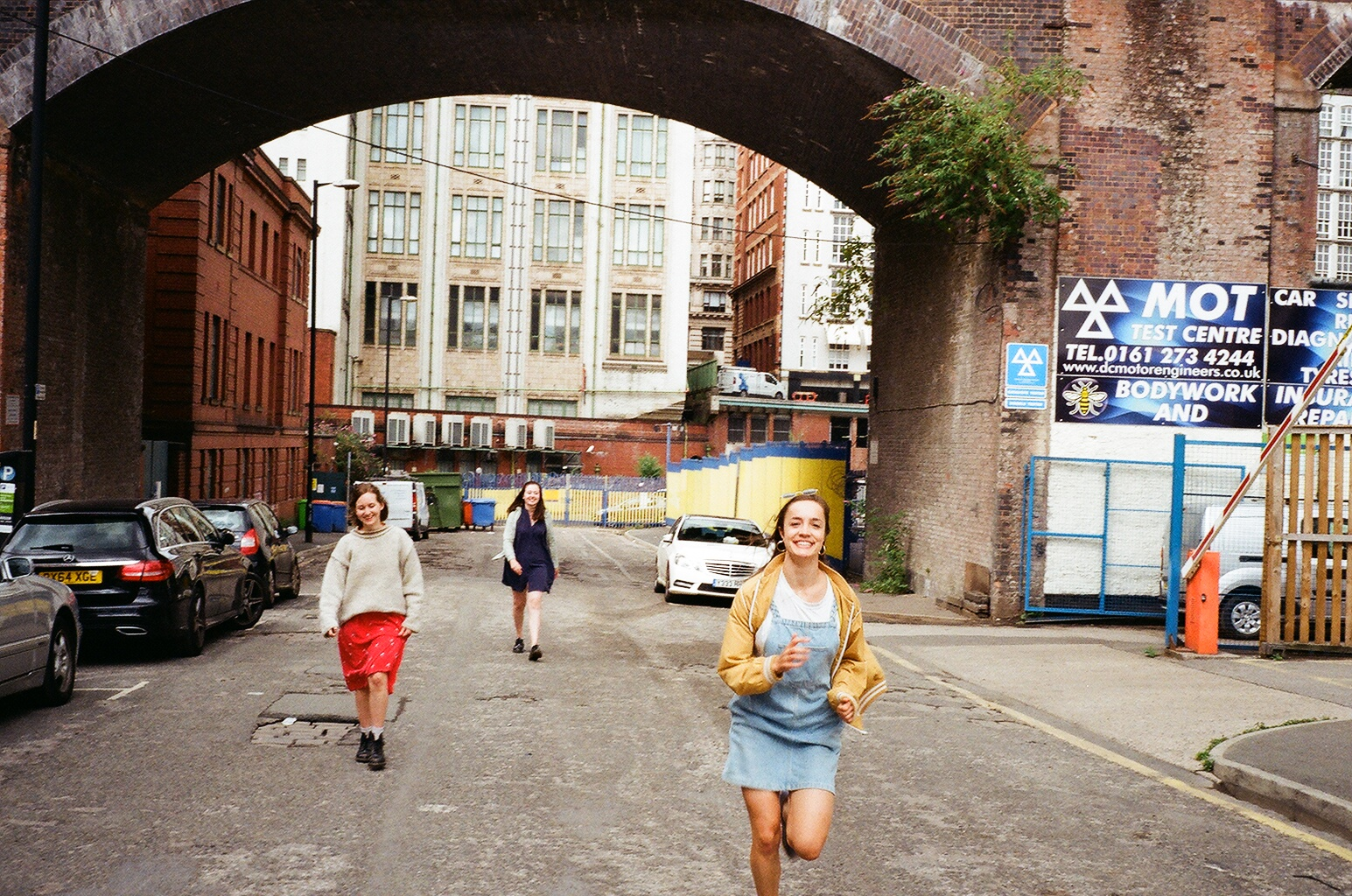 Café Spice band running under railway bridge