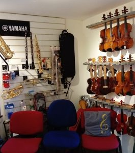 Inside shop violins displayed on wall