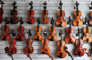 17 String instruments displayed on wall
