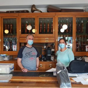 Two shop staff with covid safe face masks