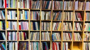 book shelves full of sheet music