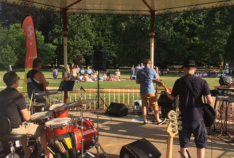 Musicians playing on a bandstand