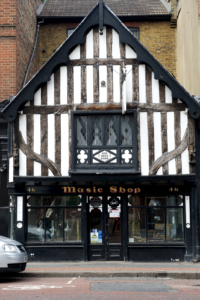 Just Flutes old Tudor store front