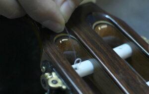 securing strings in tuning peg