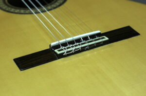 restrung strings viewing on body of guitar