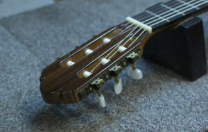finished restrung guitar viewing from neck of guitar