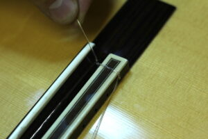 tying knot on guitar string
